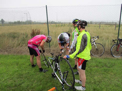 Pascal Dorney gets a puncture at kilometer 20