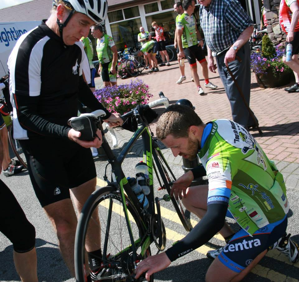 Sean kelly gives his bike to a pro for service Can yo make the gears go faster John McCarthy